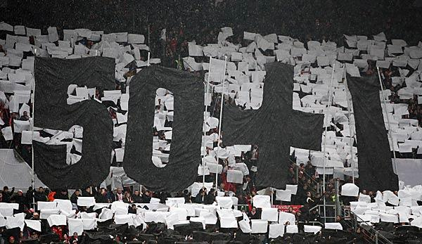 Image showing fans displaying banner reading '50+1' rule.
